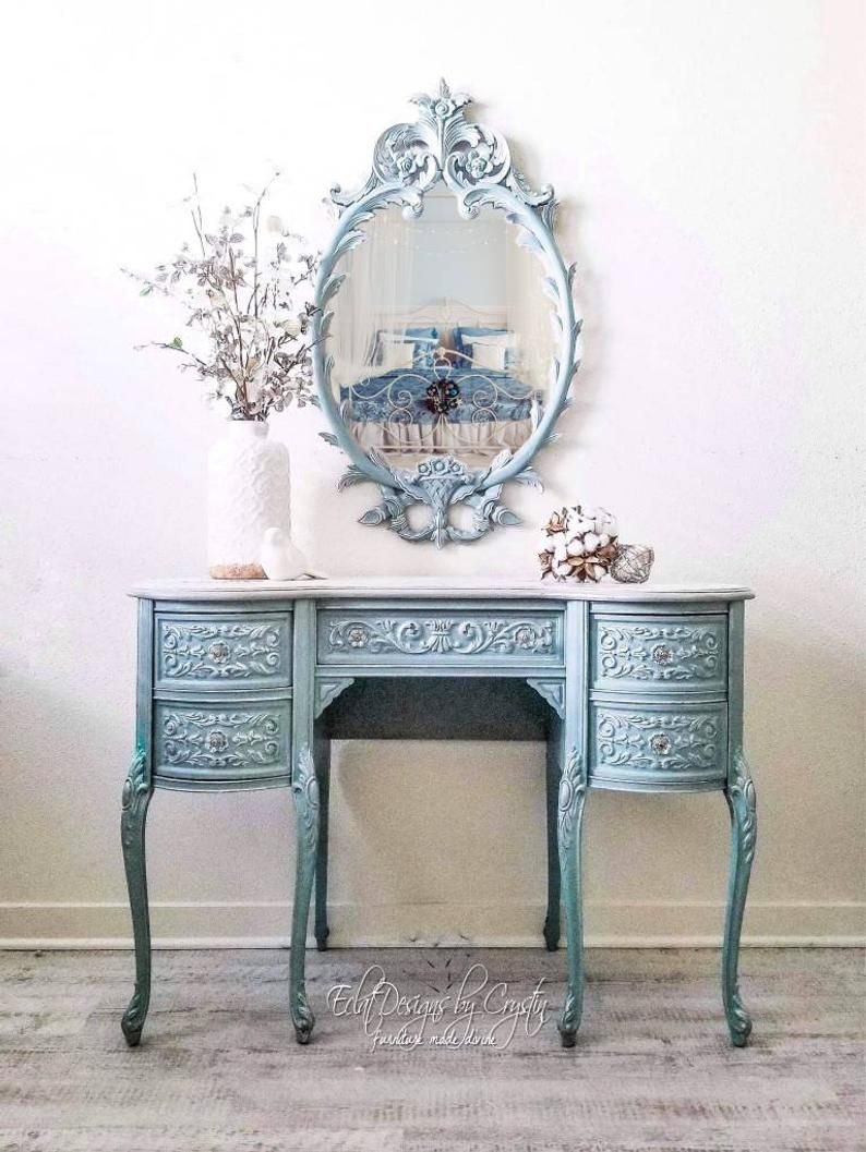 SOLD Frozen Vanity Table with Mirror is part of Vanity table - SOLD  Glamorous, antique vanity that has been painted a delicate persian blue  Silver details feature all around this desk  It has a wrap around design so that it will be a showstopper at any angle  You will never get tired looking at this beauty and applying your makeup in front of its stunning
