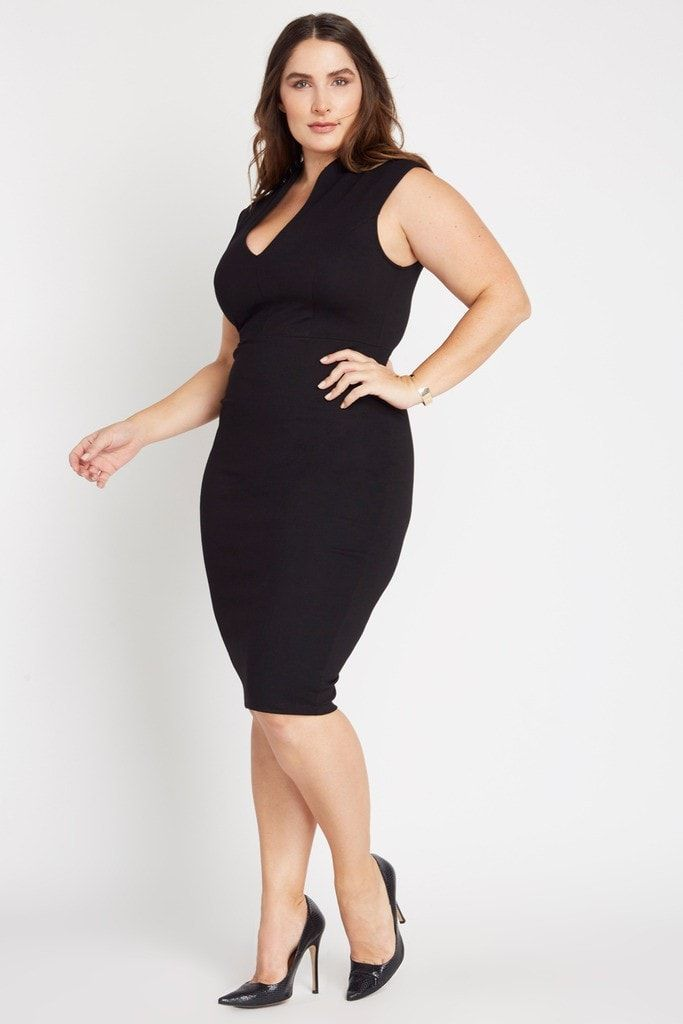 9178bb45bfd1 Luxe evening dress features deep v neckline and form fitting structure.  Hemline hits below the knee. Finished with visible back gold zipper. Dress  is un