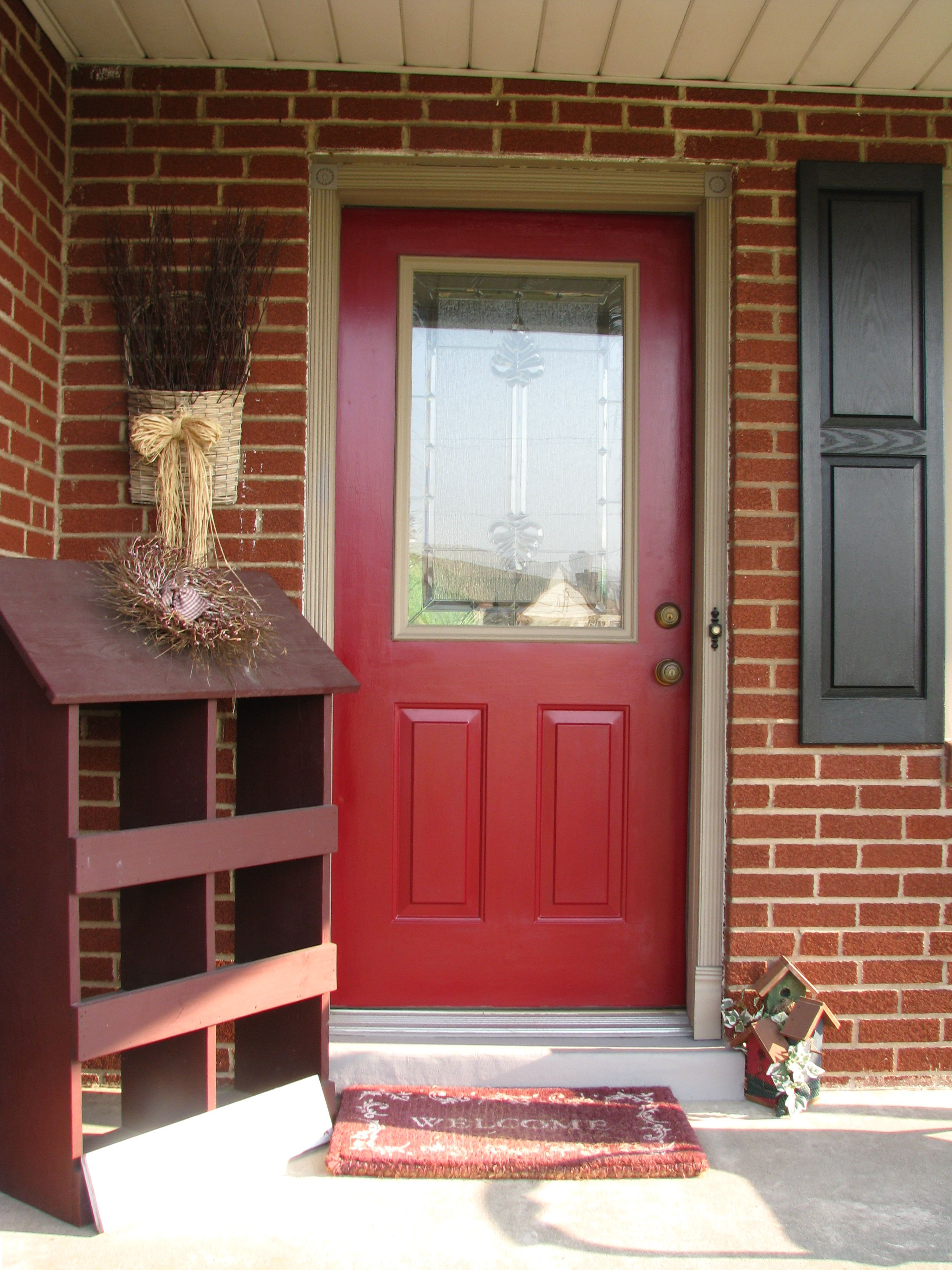 Red Brick House Front Door Colors With Black Shutters