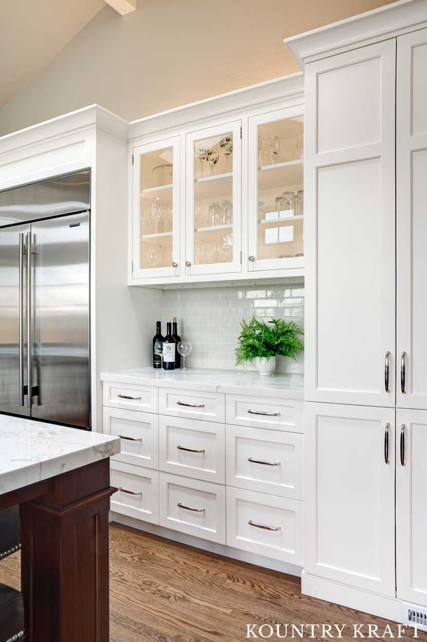 White Kitchen Cabinets with Glass Doors Was Crafted for a ...