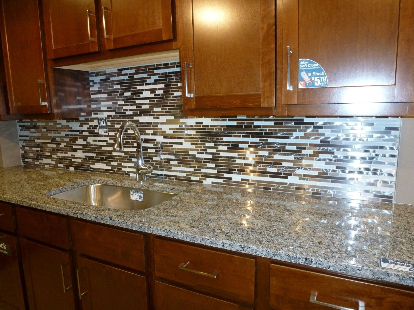 Kitchen Astounding Kitchen Backsplash Tile Ideas With Cherry Cabinets Feat Stainless Steel Sink And Arch Faucet On Granite Countertops And Kitchen Vanity