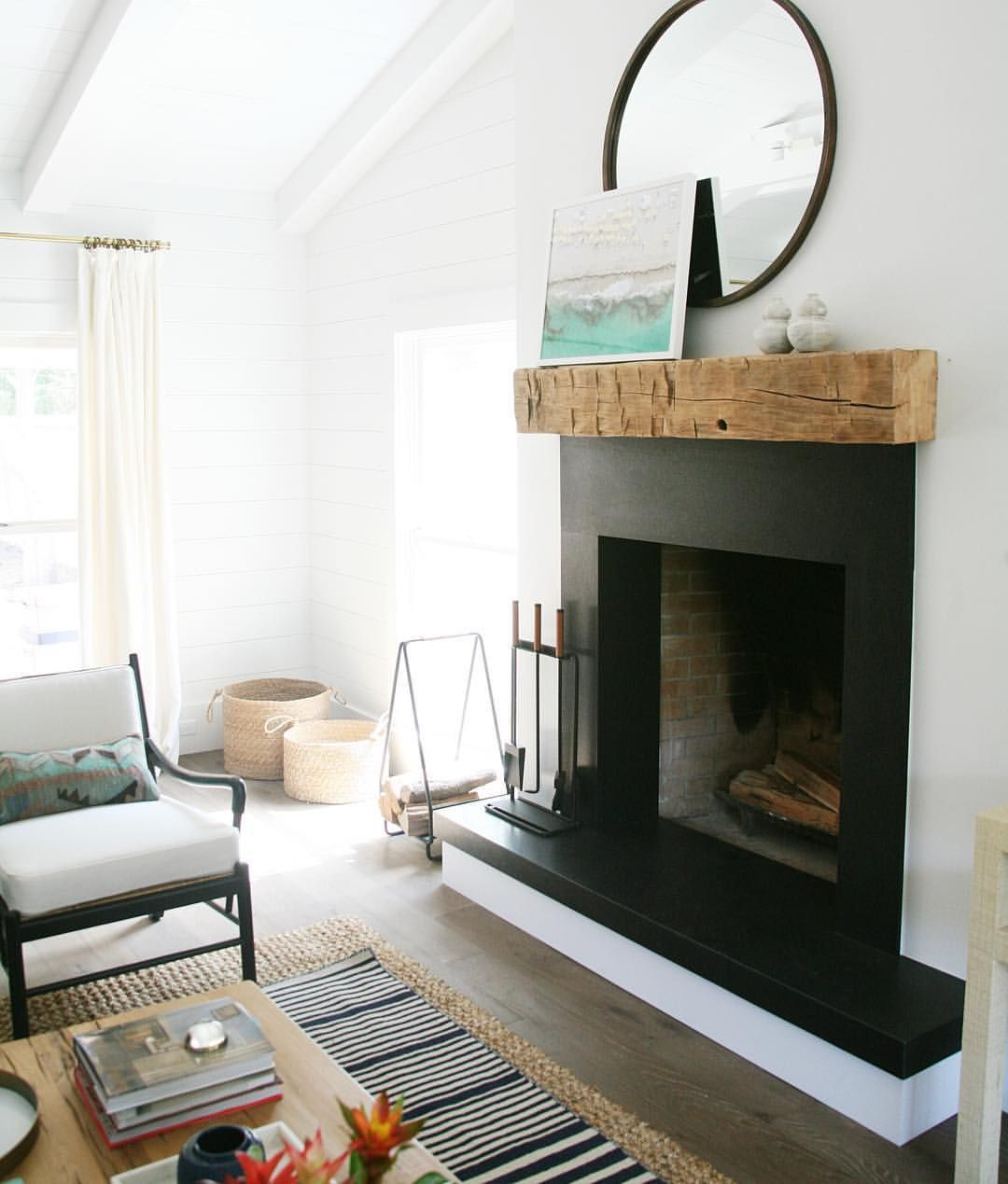 Can T Decide Between A Mirror Or Art Over Your Mantle Why Not Use Both Hang A Large Round Mirror And Tilt A Smaller Fra Mirror Over Fireplace Home Fireplace