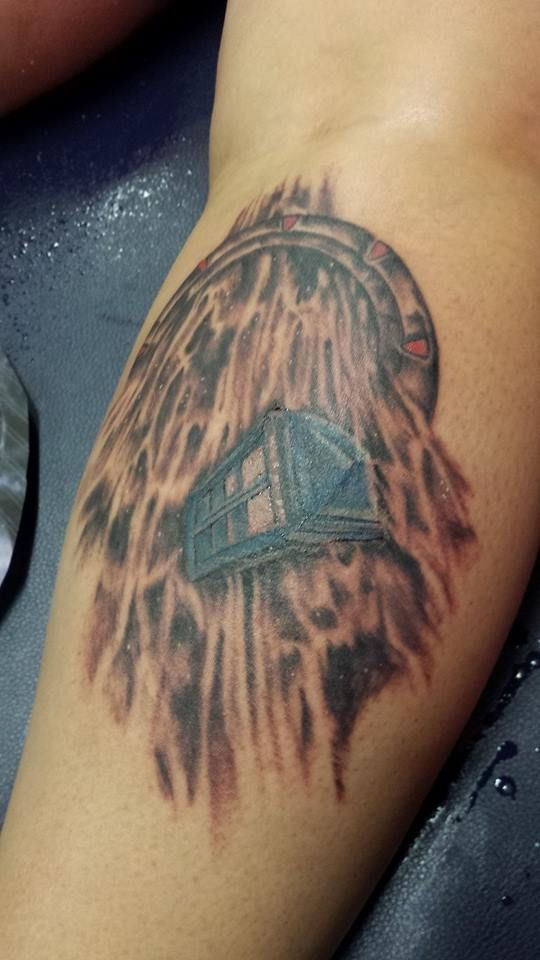 my brand new birthday tattoo a stargate wormhole with the doctor who tardis flying out of it. Black Bedroom Furniture Sets. Home Design Ideas