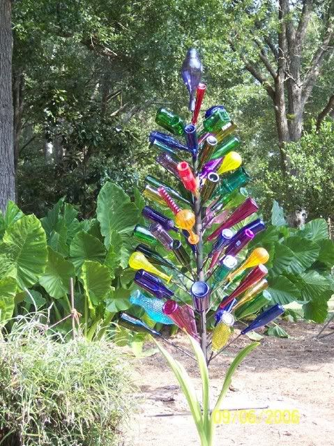 Garden Bottle Tree - made out of recycled multicoloured bottles on a wire tree. Beautiful for any garden or allotment - Craft ideas