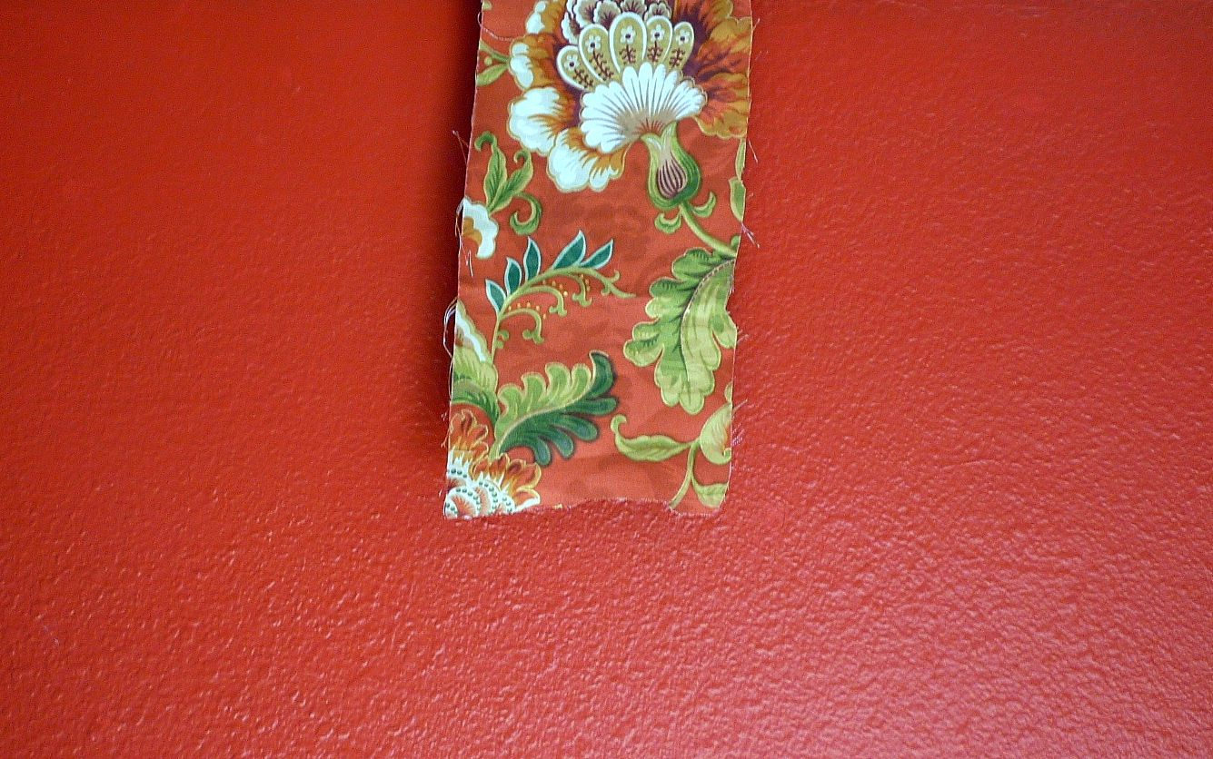 Red walls are classic for libraries, dining rooms, and entry halls. I'm also using red in a client's living room with simple stationery drapery panels between and flanking the windows. The print is a contemporary spin on a chintz pattern. The white, green, and touch of yellow/gold will bring the room to life. More at bit.ly/1kEXMlM