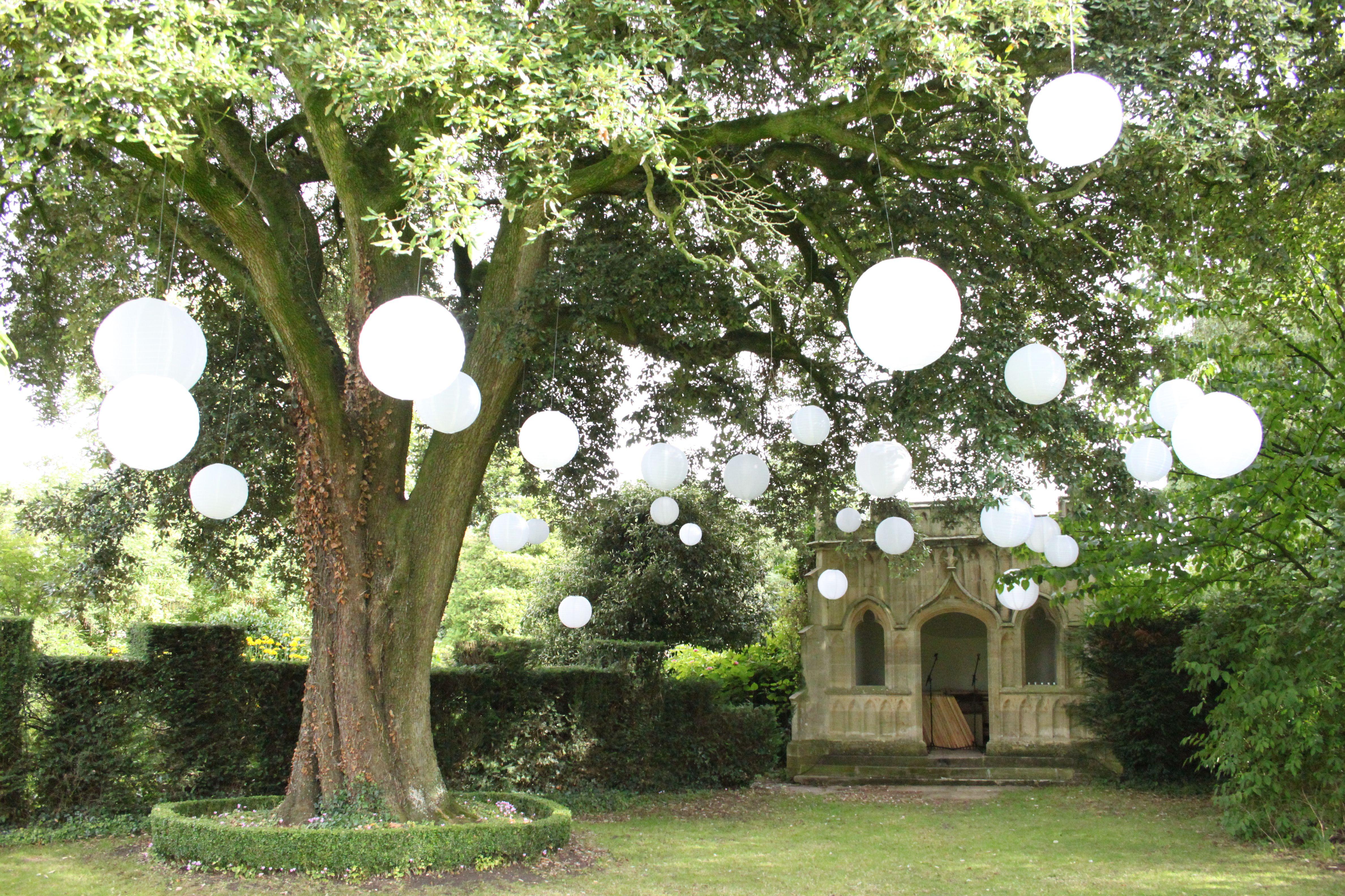 White nylon outdoor lanterns create this beautiful \'Secret Garden ...