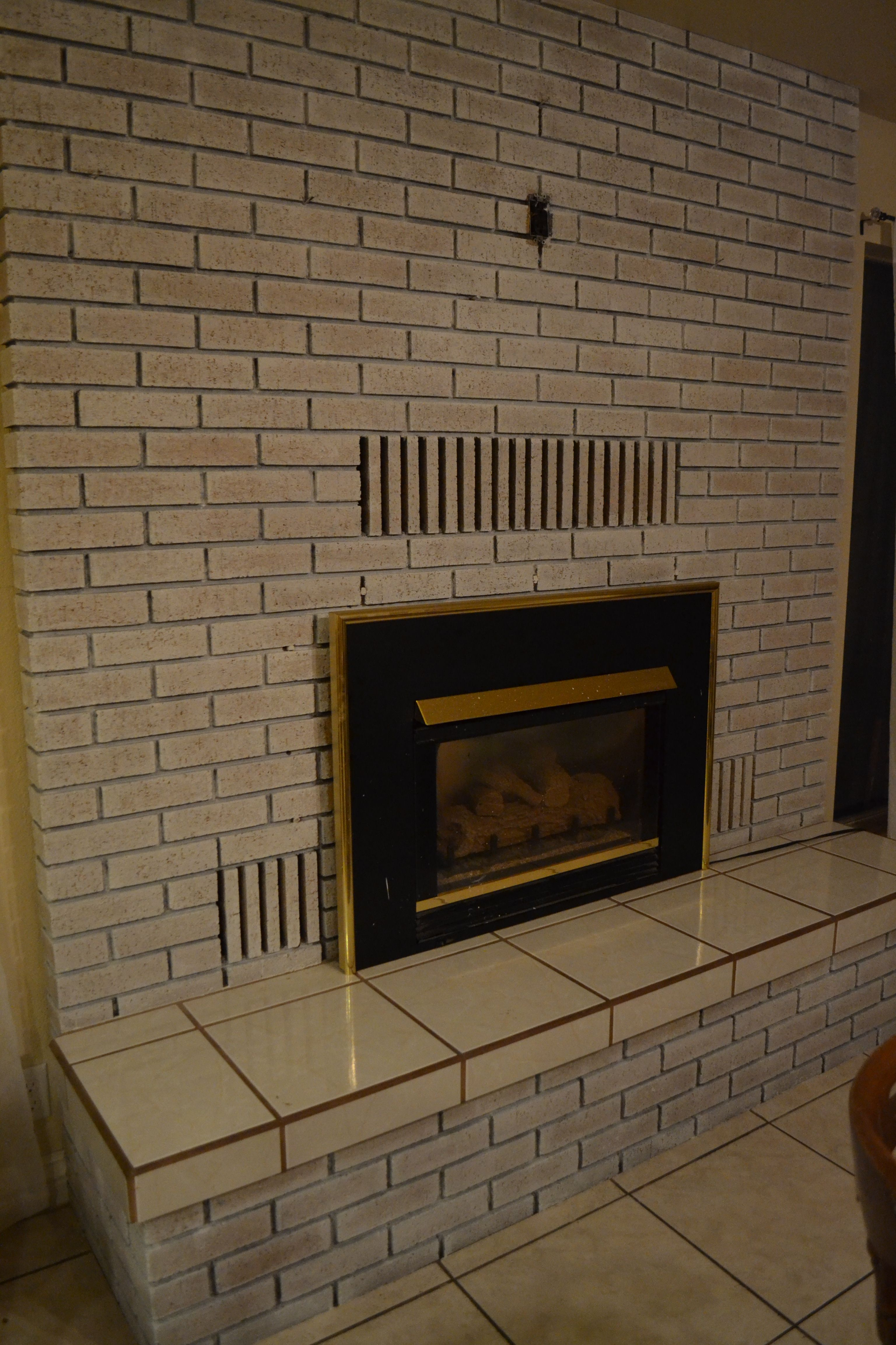 Whitewash Your Outdated Yellow Brick Fireplace Brick Fireplace Yellow Brick Houses Fireplace