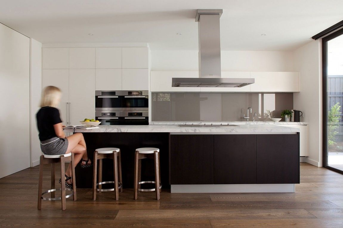 Uncategorized Kitchen Appliances Brighton wall oven panels with central rangehood over island bench and kitchen reno