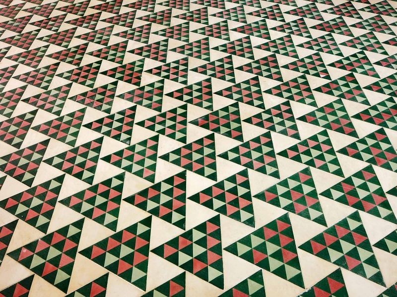 new mosaic floor to apartment - triangular pattern echoes form of plan - colour tones indicates realms of occupants - Carrer Avinyo 34 - Barcelona David Kohn - 2011?