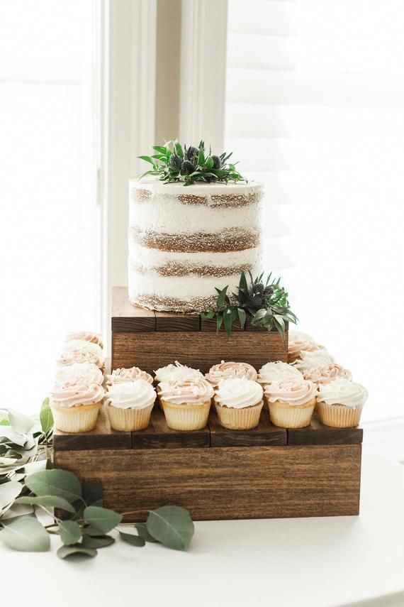 """Rustic Cupcake Stand   Rustic Wood Cake Stand   Rustic Birthday Cake Stand   Rustic Cake Stand   Wedding Cake Stand - NEW - WS-185 by Sweet Carolina Collective DETAILS: This listing is for one rustic cupcake stand or cake stand. Buy it as a single item for a cake or stack them for multiple dessert variations! Save 10% off your order (non rush orders) by signing up for our newsletter! https://bit.ly/2PBTGl3 (does not apply to acrylic / wood stands) VERSION SHOWN IN LISTING: -Dark walnut stain -White paint -5"""" (tall) 14""""x14"""" ______________________________________ STAND SIZES (all stands are 5"""" in height): 12""""x12"""" 14""""x14"""" 16""""x16"""" 18""""x18"""" 20""""x20"""" ______________________________________ STAIN COLORS: -English Oak -Dark Walnut -Weathered Gray ______________________________________ HOW TO ORDER: -Choose your stain and stand size -Let us know what you want your cake stand to say in the personalization block  -Add to cart -Checkout! *Want multiple levels?  Send us a message and we can create you a discounted listing *We can make anything custom! Contact us with your ideas or questions ______________________________________ SHIPPING: -UPS Ground in 3-5 business days or USPS -Rush orders available, please contact me for pricing prior to purchase -Approximate ship date can be found on your invoice -We always provide tracking numbers and insurance on each order ______________________________________ NEED DESSERT BLOCKS?  BUY THEM HERE:  http://etsy.me/2m6G6b9 © 2012-20 Sweet Carolina Collective, LLC all rights reserved. All products, images, styling and text are copyrighted and intellectual property of Sweet Carolina Collective, LLC"""