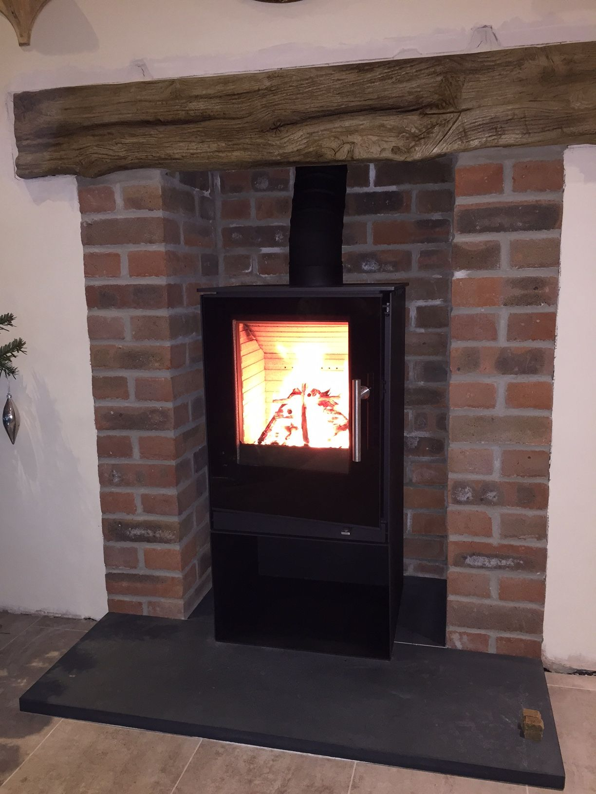 Rais Qtee 57 On Log Store With Glass Door Slate Hearth And Timber