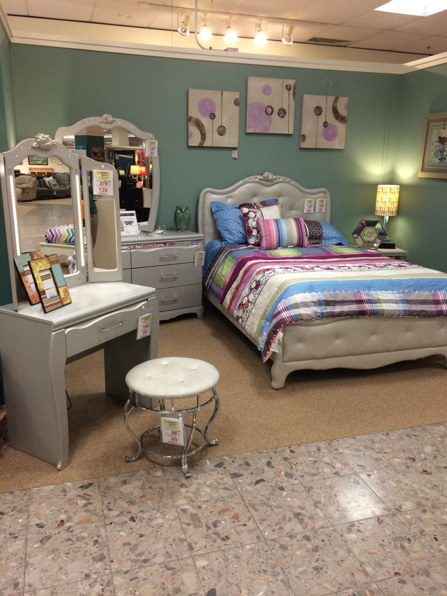 Ashley Zarollina Upholstered Bedroom Set On The Showroom Floor At