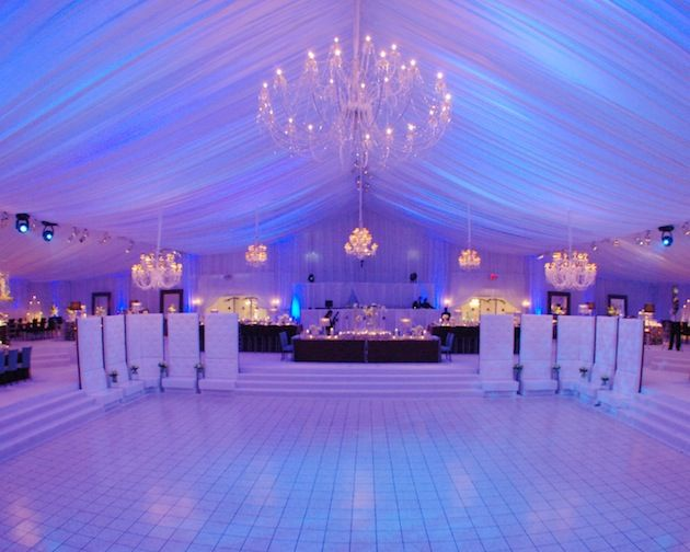 Simply beautiful. I love the draped ceiling, the chandeliers, the blue lighting, the tiled dance floor, everything :) - wooooow that is so cool!!