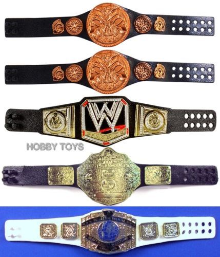 WWE Tag Team Championship WWE Championship World Heavyweight Championship & Intercontinental Championship