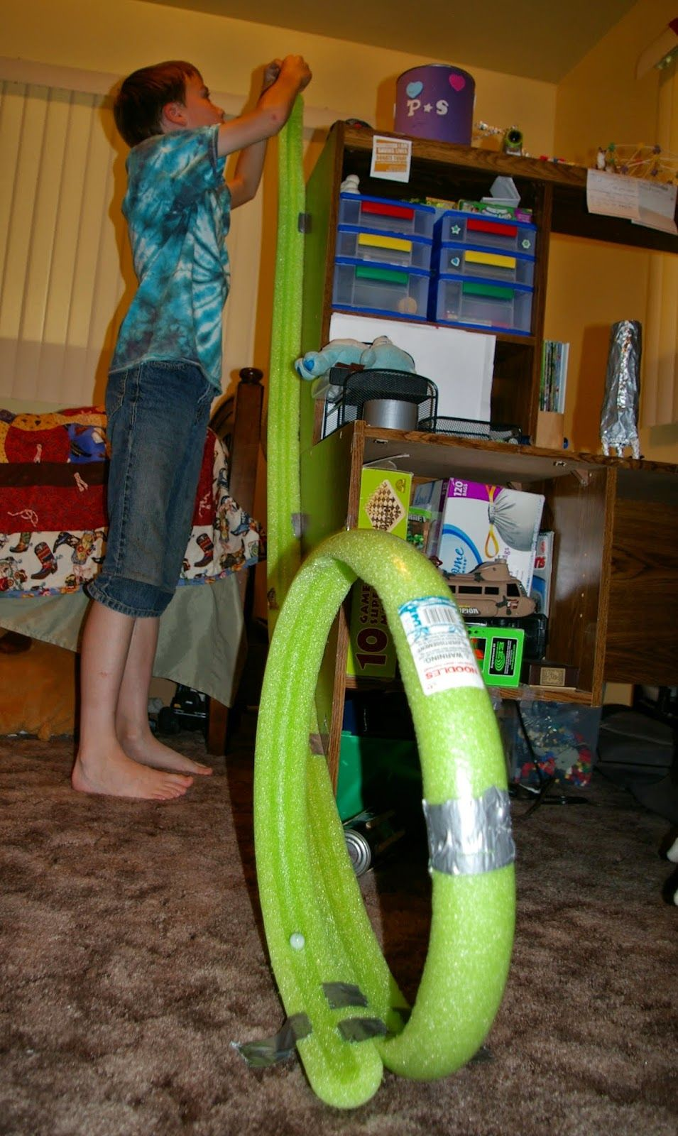 Make a marble race track out of pool noodles! Pool
