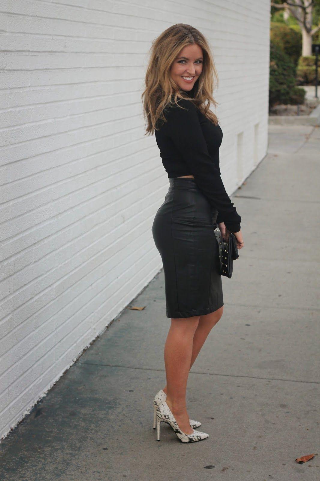 black faux leather skirt, black crop top, snake heels ...