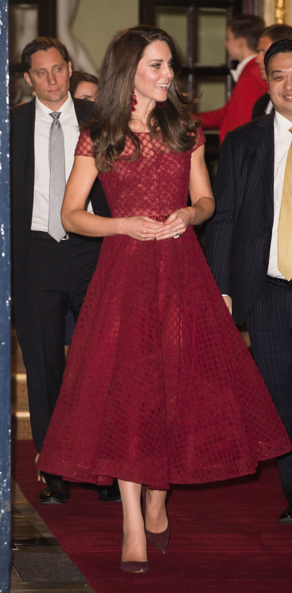 b6e993d5 Catherine, Duchess of Cambridge, wearing a red embellished tulle midi dress  by Marchesa Notte