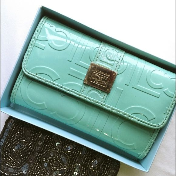 Liz Claiborne~ Seafoam Wallet Seafoam wallet by Liz Claiborne, has been used multiple times..no stains though..in great condition comes in original box.. Liz Claiborne Bags Wallets