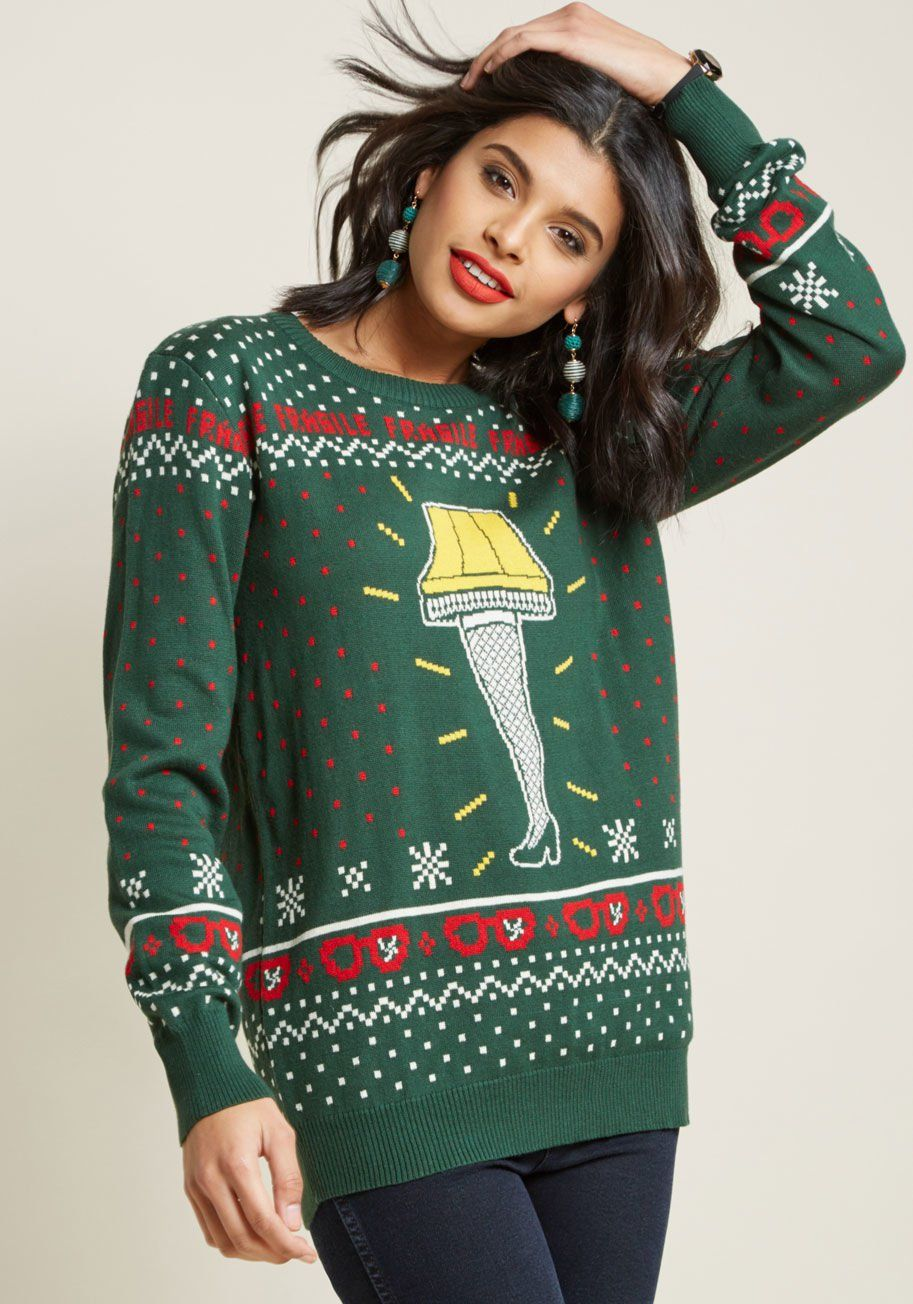 2877d069e7c2f Get a leg up on holiday fashion with this pine green sweater! In a yellow,  red, and white intarsia knit, this pullover stars the iconic lamp from A..