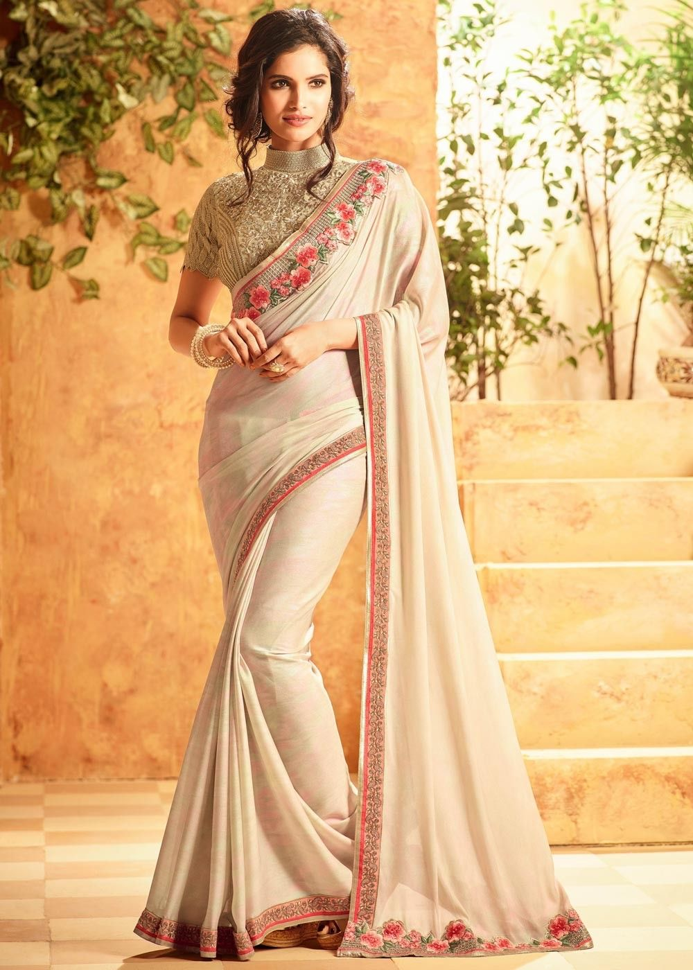 2abe1cdab9db79 Look gracious by  draping this  beige  georgette  saree with  shimmer  effect and light floral  embroidered  zari border.H