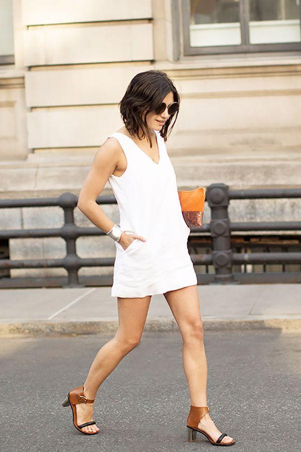 5a49c043773e Garance Doré of Garance Doré in a white mini dress + heels + orange clitch