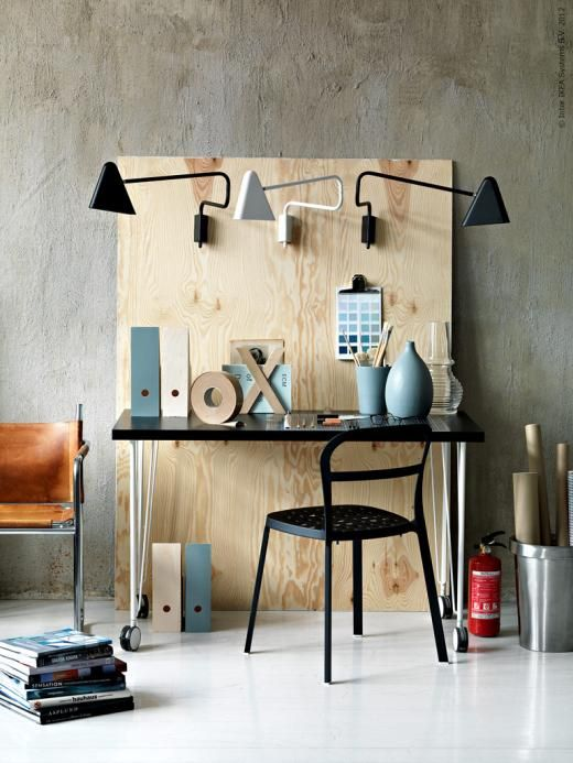 Nice interior design idea. Prop up a wood board to create a wall for lighting / hanging. Also helps define space better.   inspiration från IKEA