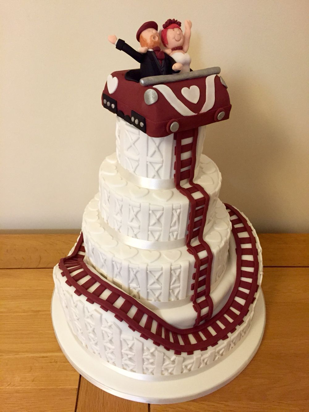 A Four Tier Wedding Cake With An Unusually Roller Coaster Theme Tiered Wedding Cake Cake Wedding Cakes