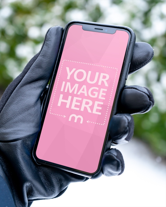 Download Mockup Template Featuring A Man With Leather Gloves Holding An Iphone Xs In Hand Outdoors Upload Your Own Image And Promot Iphone Mockup Photoshop Mockup Free