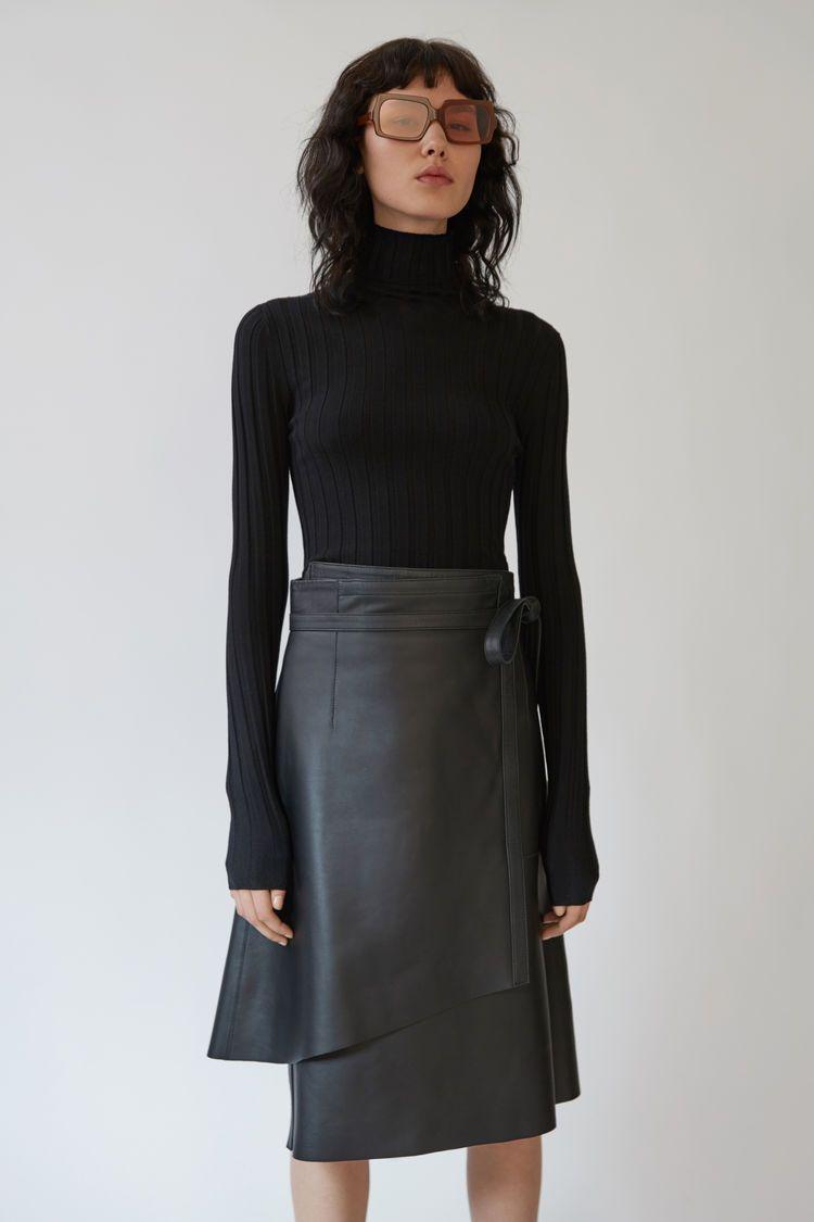 7543f43bee2 Acne Studios Corina Merino black is a body conscious ribbed turtleneck  sweater.