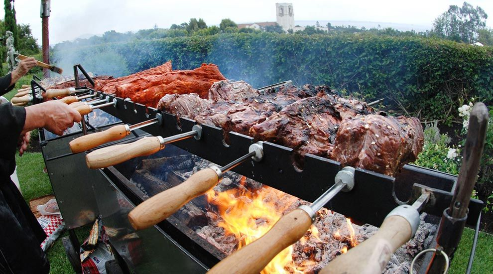 Brazilian Bbq Grill Station Chef Manned Oak Fire Rotisserie Meats Carved Off The Grill Swords On Wedding Food Stations Brazilian Bbq Backyard Wedding Catering
