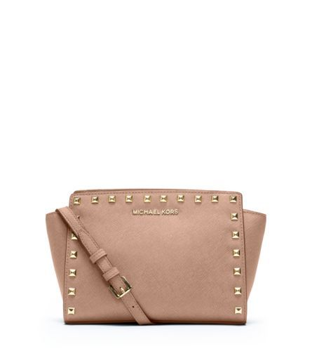 Get the trendiest Cross Body Bag of the season! The Michael Kors Selma  Studded Medium Messenger Blush Cross Body Bag is a top 10 member favorite  on Tradesy.