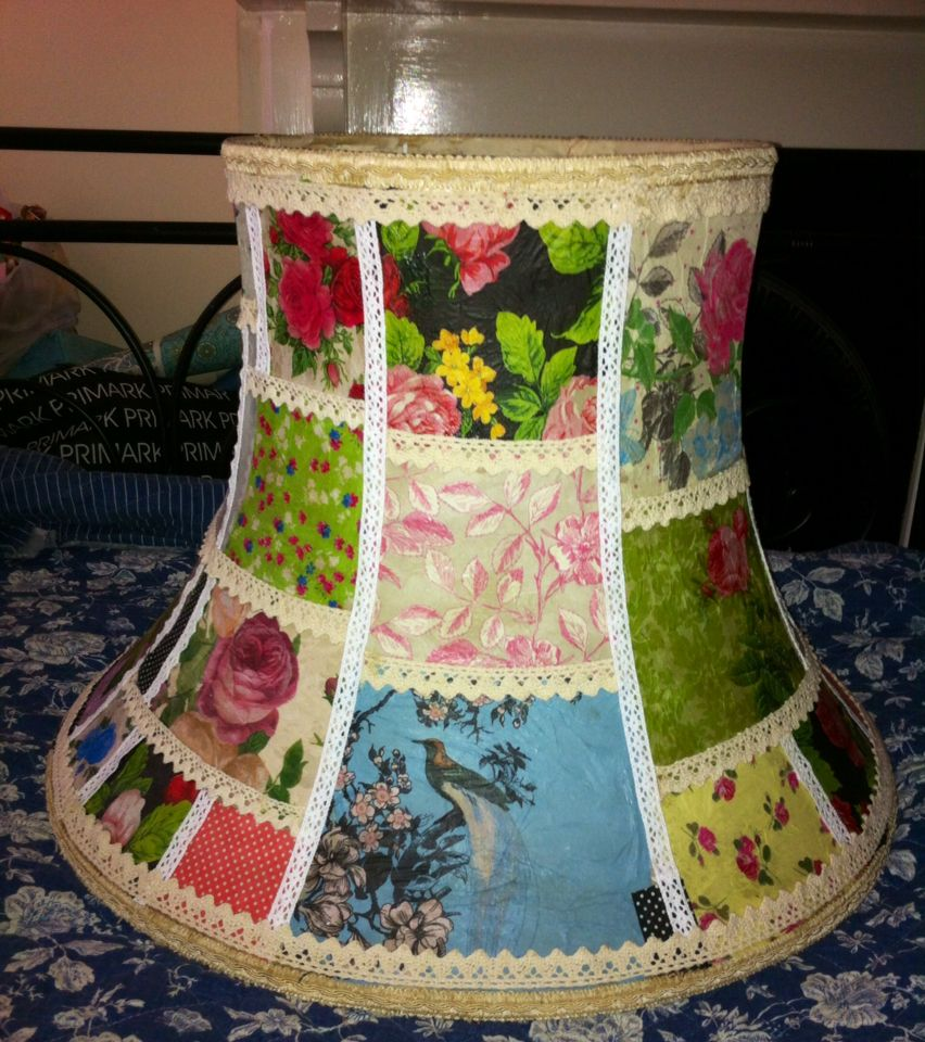 Decoupage lampshade with napkins and trimmed with lace the
