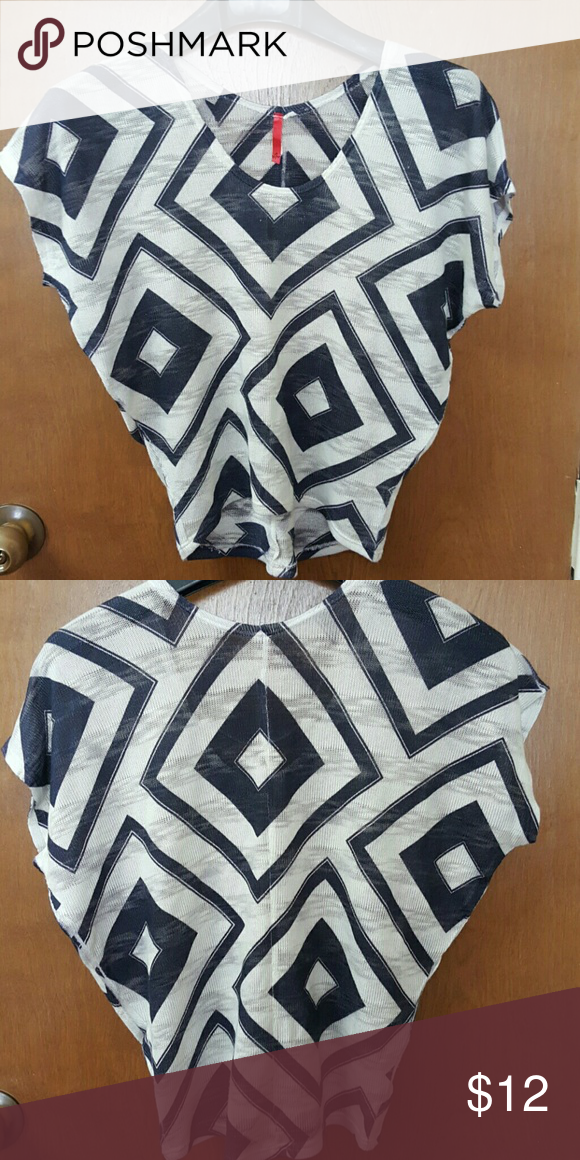 Cute cap sleeve top Cute design, thin shirt. It is very shear, cream and blue color. Says M, but I would say veey well suited to S/M. motive Tops
