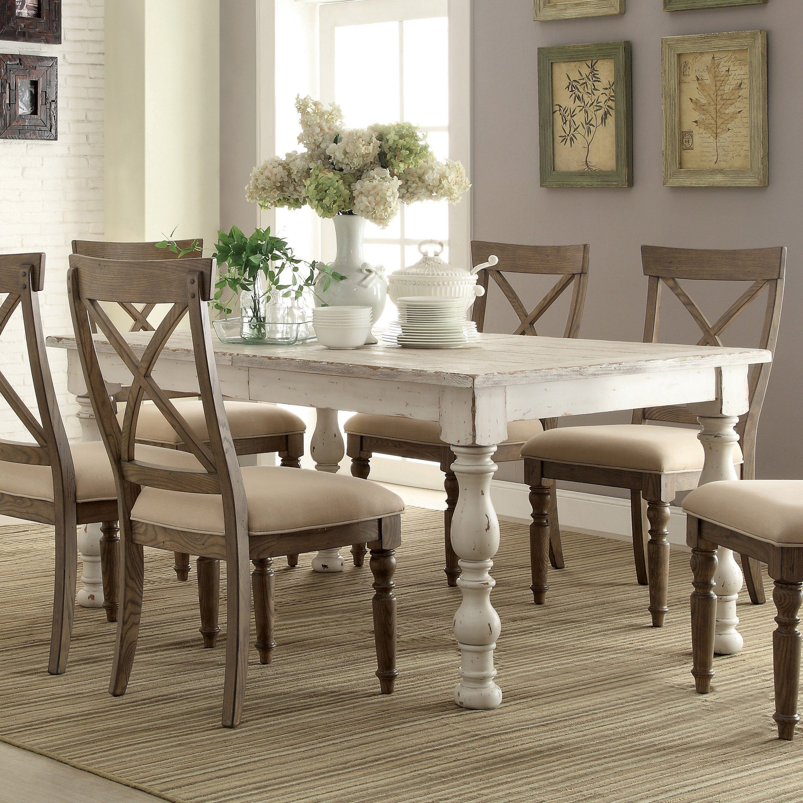 dining table and chairs in weathered worn white by riverside furniture