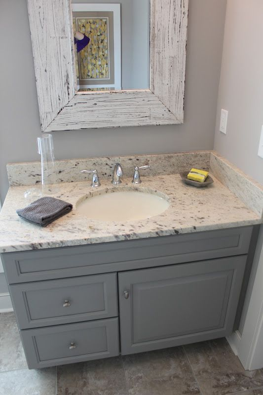 Good color for bottom cabinets with creamy white on top for Bathroom ideas grey vanity