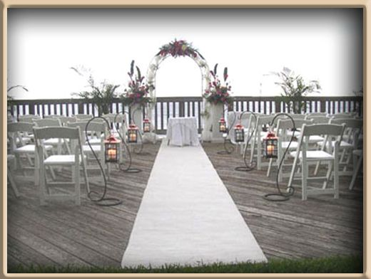 White Wedding Aisle Runner Displayed For An Outdoor Ceremony