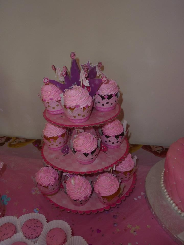 princess cupcakes wraps with pink frosting and off white pearls spread on top
