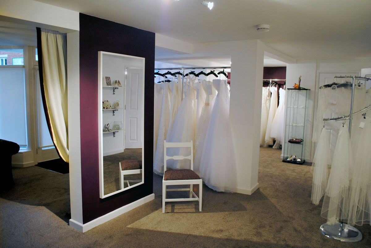 Wedding dress shop interior design for Wedding interior decoration images