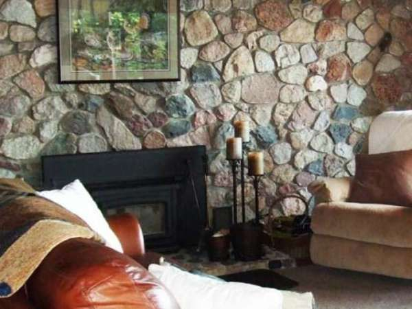 Fieldstone Fireplace at this North Twin Lake Home for sale -- 4365 Wright Way, Conover, WI 54519