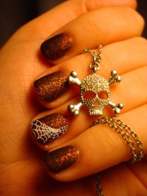 orange glitter with web with images  halloween nails
