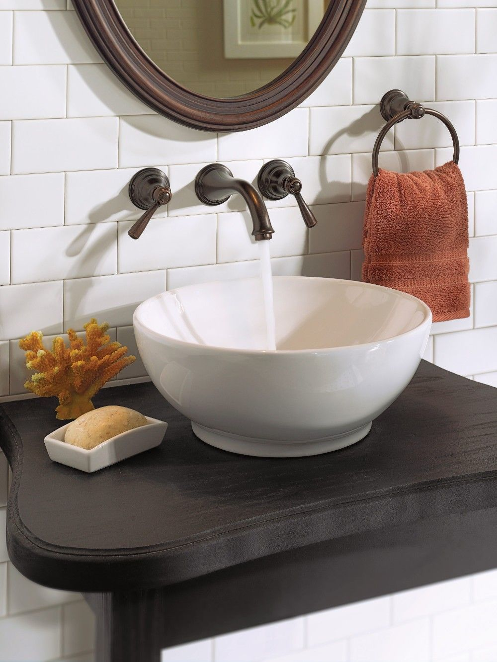 master bath faucet - Kingsley Oil rubbed bronze two-handle low arc ...