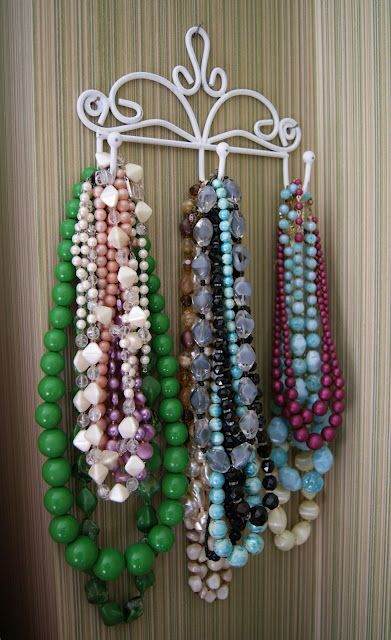 Necklaces on a cute coat rack.