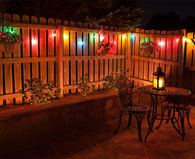 Color matters make the right patio lights color choice dinner colorful globe patio lights illuminate a backyard dinner party plus more great outdoor lighting ideas aloadofball Gallery