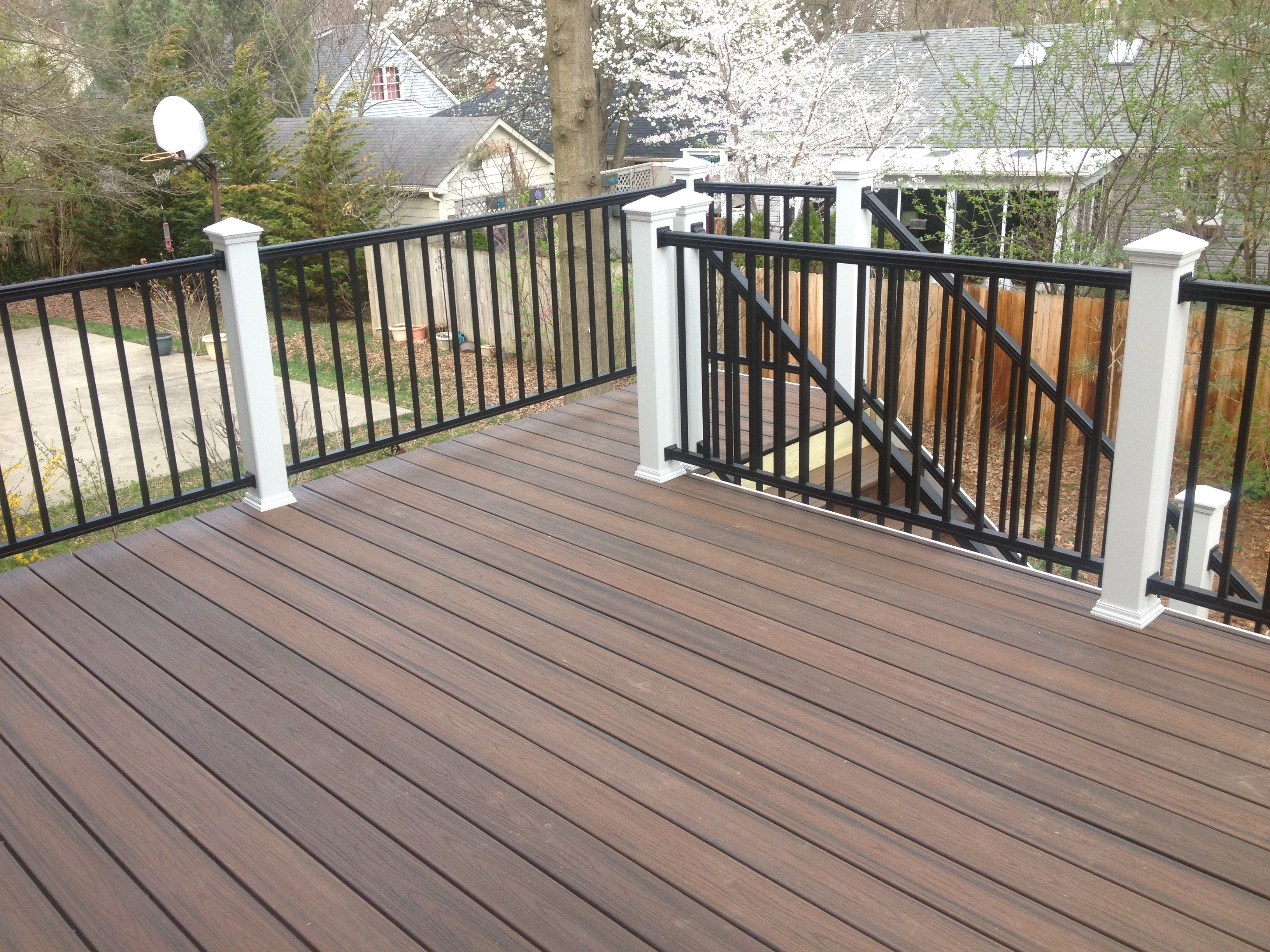 Trex spiced rum decking with white post sleeves and black for Composite deck railing
