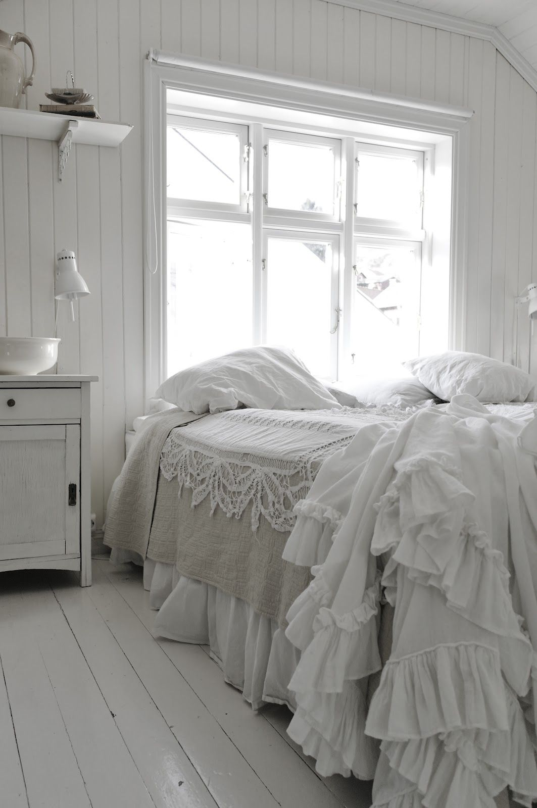 White bedroom with contrast of natural bed cover, lots of
