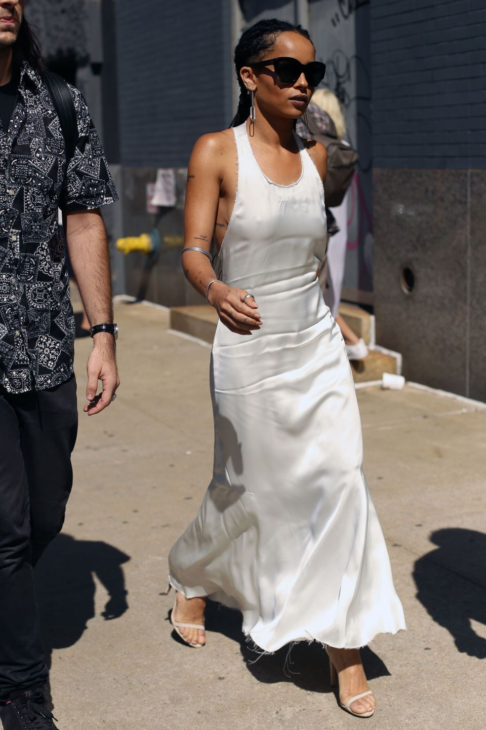 Vintage items that are back in style and worth the splurge. Seen here: Zoe Kravitz in white slip dress on the streets of nyc. #zoekravitzstyle