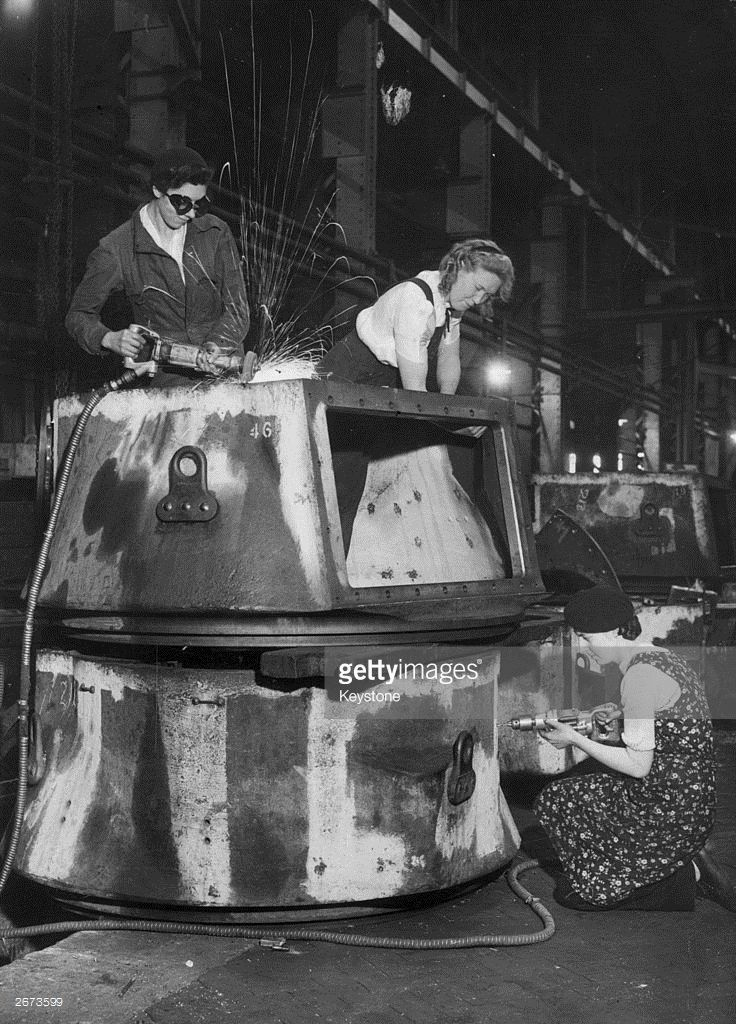 From left to right, Mrs Hilda Poole, Hilda Partington and Madge Scott working on a 'waltzing matilda' in a tank factory.