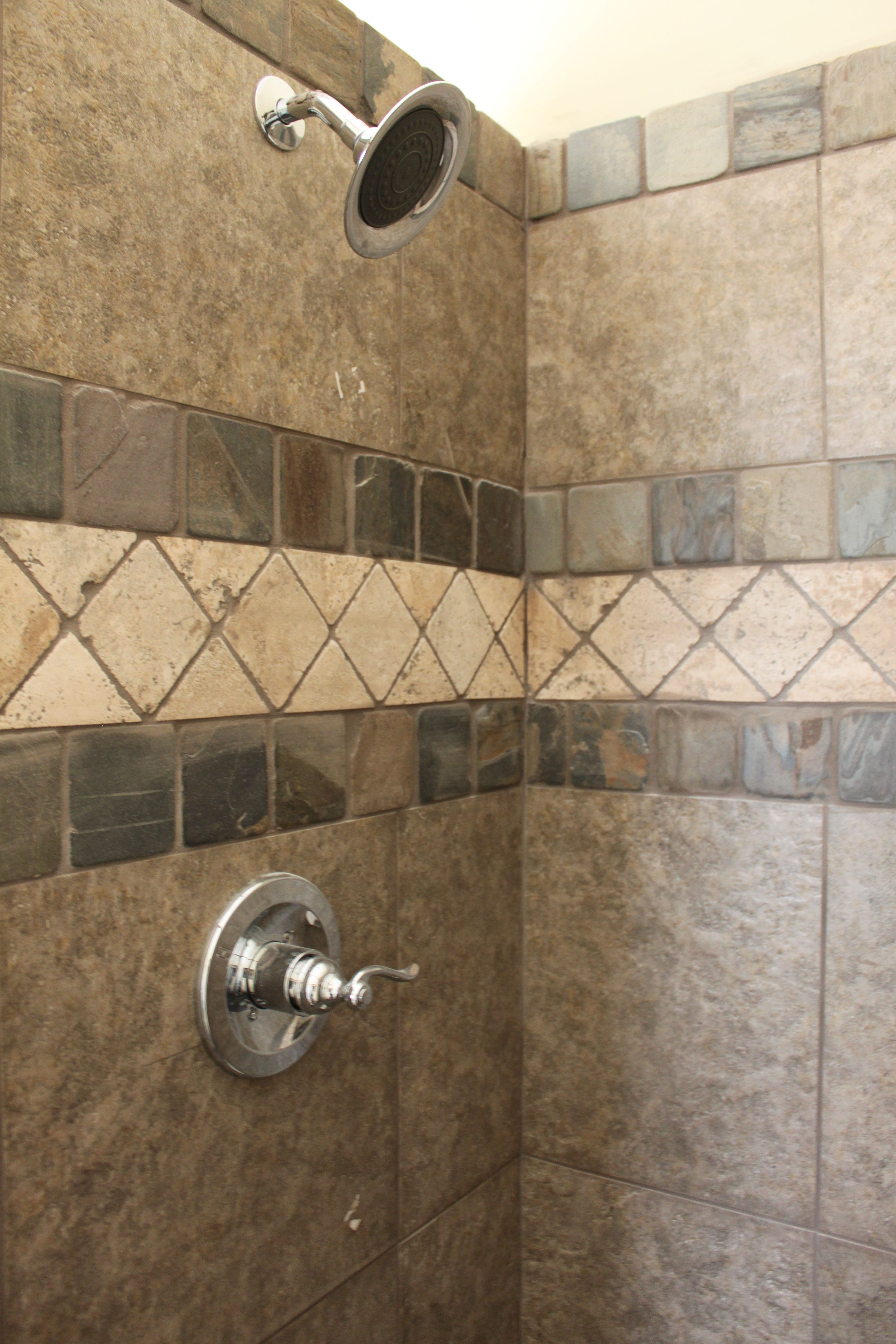 ceramic tile shower with tumbled marble feature