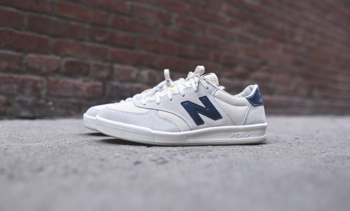 8afad0d1f96e8 Spring sneaker fever. White and navy New Balance CRT300 available at ...