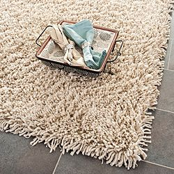 @Overstock - Hand-woven Bliss Taupe Shag Rug (9'6 x 13'6) - Add interest to your home decor with a hand-woven rug Casual rug features shag pattern with taupe accent  Area rug is crafted of high-density acrylic    http://www.overstock.com/Home-Garden/Hand-woven-Bliss-Taupe-Shag-Rug-96-x-136/4400852/product.html?CID=214117  $649.29